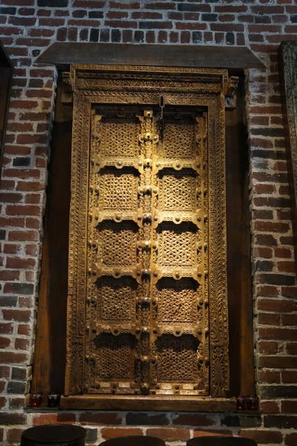 Antique hand carved double door with original brass & iron work.
