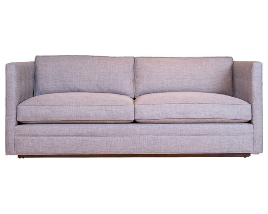 Fairmont Sofa - Featuring blind tufted arms and loose cushions, the Fairmont sofa is a minimalists dream.
