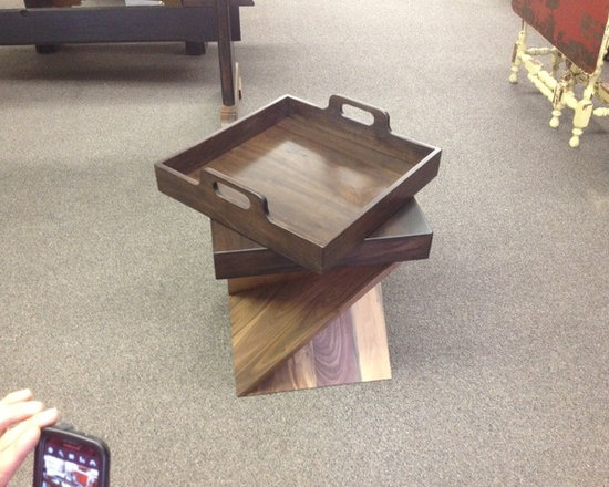 """Walnut """"Cap Trays"""" - These are a set of solid walnut serving trays that were designed by Dixie Niichel to invert when not in use and become table tops for a set of multipurpose walnut and leather seats. We had fun with these and love any project that adds to the versatility of existing furniture!"""