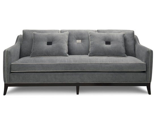 Sutherland Sofa - Sutherland is truly a unique sofa, designed for those with discriminating taste and attention to detail. Shown with contrast piping in pale gray layered on a slate blue microfibre body, it features a full bench cushion for a clean look and unique square button-tufted cushions. This sofa is as comfortable to sit on, as it is stunning to look at. The Sutherland is a statement piece for any room in your home.