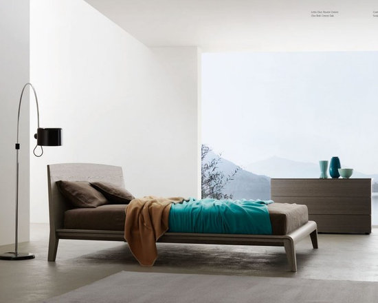 """Cloe Bed - The perimeter """"straight"""" lines contrast with the sweet curvature of headboard and foot board, making Cloe a rigorous and at the same time reassuring bed. Each formal and structural detail is designed to inspire well being to the daily rite of sleep. Stylish, wooden platform bed. Contact info@casaspazio.com for more information."""