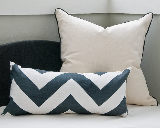 Zig - Zag Pillow - Don't underestimate our handsome zig-zag lumbar pillow. It may be small in size, but it throws a mean graphic punch. Its contemporary, broad charcoal and white stripes will infuse a playful dose of pattern into any room. A hidden bottom zipper secures the insert. Made in the USA.