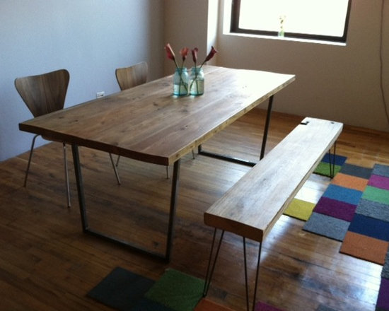 dining table - reclaim wood dining room table and bench made with steel legs.
