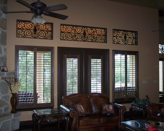 Stained wood shutters and Faux Iron - South Texas