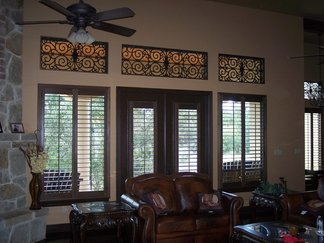Stained Wood Shutters And Faux Iron Traditional Window