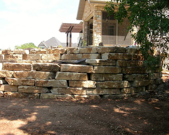 Weathered Edge Outcroppings - If you're looking for a little less structure and little more unbridled natural character, meet our Weathered Edge Outcropping. This robust, unrefined stone is available in rich, earthy shades of brown and rust. It's easily stackable and performs beautifully in landscaping accents, but it can also be used in retaining walls.