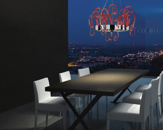 ASPID Wall Lamp by Leucos - ASPID Wall Lamp by Leucos. Decorative wall sconce consisting of hand blown curly glass mounted on a polished chrome structure. Available in : crystal and red. Companion pendant designs also available. ASPID Wall Lamp by Leucos are designed by Danilo De Rossi.