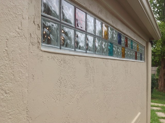 Exterior view of colored glass block transom in a stucco for Exterior glass walls