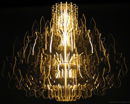 """Eco Friendly Furnture and Lighting - Made from 16 transparent contours illuminated by a fluorescent bulb, this chandelier provides a modern reincarnation of the traditional chandelier. Through the use of special materials and accurate CNC milling techniques the whole body of this fixture emits a magic light. Together with table lamp """"Marie-Louise"""" and floor lamp """"Josephine"""" this sophisticated design is part of a series of unique lighting fixtures, which are guaranteed eye catchers in any interior."""