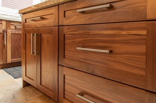 Has a stain been added to the walnut wood cabinets if so for Walnut kitchen cabinets