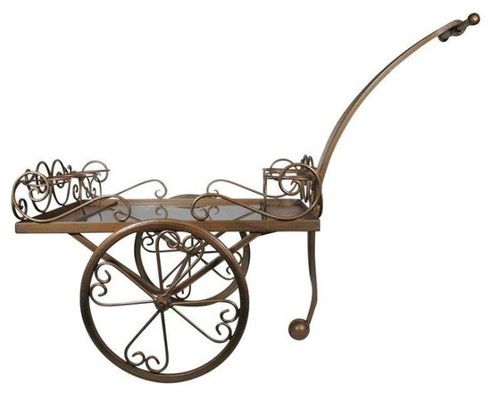 Pre-owned 1970s Scrolled Iron Beverage Cart - This 1970s scrolled iron and smoked glass piece is one of the fanciest bar carts we've ever seen! It has a lovely gold patina and is in excellent vintage condition.