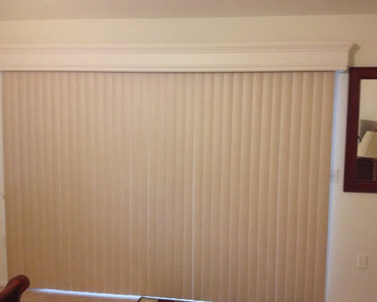 Blinds & Shades - A neutral vertical blind topped off with a beautiful painted wood cornice.