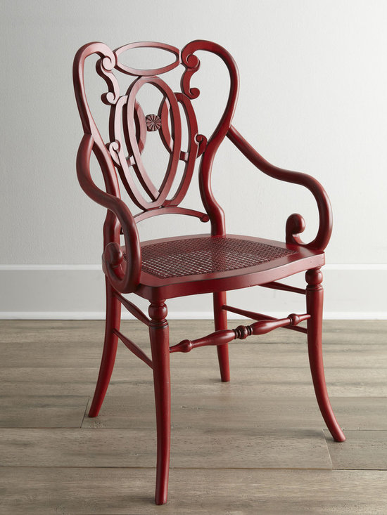 Davinia Rattan-Sear Chair - Beautifully distressed for an antique look, this versatile chair with intricately curving arms and back works in the dining room, entryway, or any living space. Select color when ordering.
