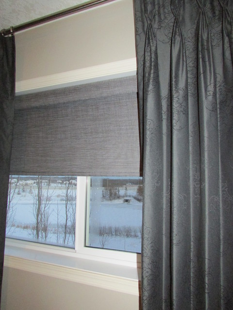 Stationary Pinch Pleat Drapes Over Operable Roller Shade