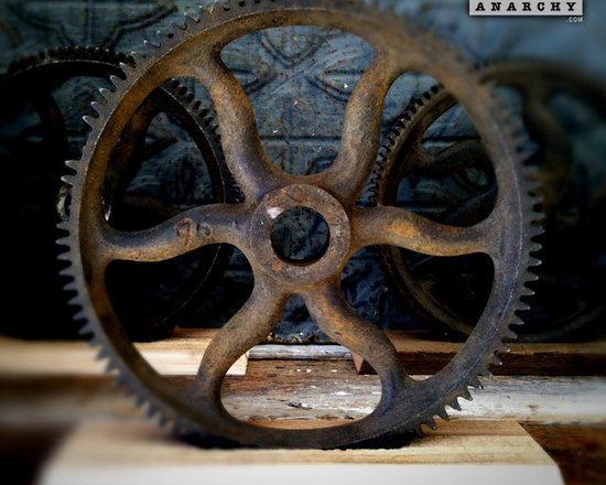 """Antique Industrial Gear Decor - Turn-of-the-century numbered gear of cast iron in a very dynamic industrial style! Luscious old patina with its original black painted finish. Marked: '96. Sits in a rustic reclaimed lumber display stand. 8"""" diameter."""