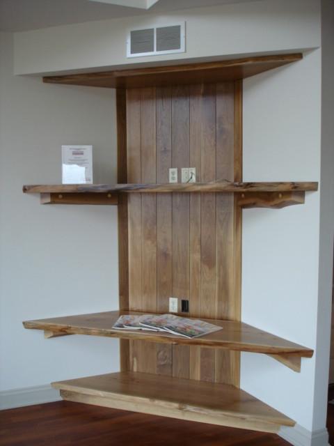 Custom reclaimed wood shelving traditional-living-room