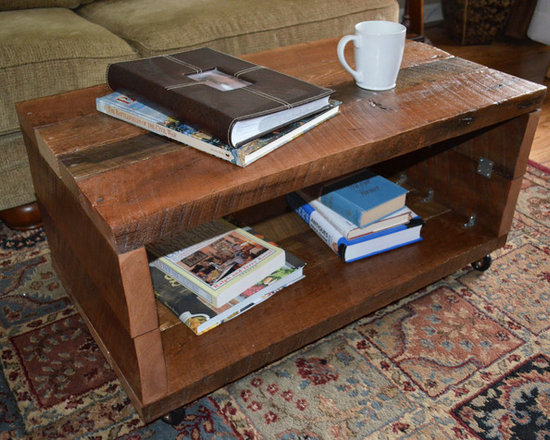 """Reclaimed Wood Coffee Table - Handmade reclaimed wood coffee table. Rustic barn beams from a barn in West Sunbury, PA were used to create this piece. Measures 35""""L, 15""""W, 16""""H. Sits on casters for easy moving. This specific piece is not for sale, so finished look may vary depending on materials sourced."""