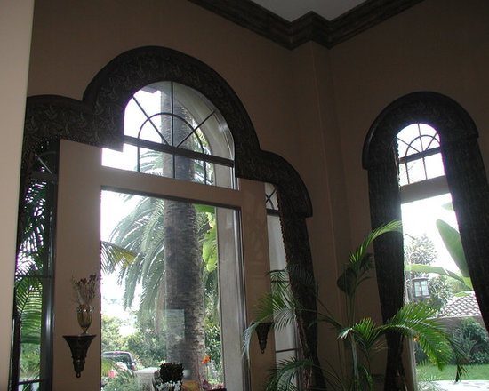 Cornice boxes - Arched top cornices to match shape of windows with stationary tiebacks beneath.