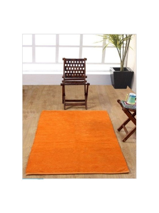 Chenille Plain Rug Orange - This delightful hand woven rug is available in many beautiful plain colours in five sizes. These solid or plain coloured rugs can be very well coordinated with Homescapes chenille cotton stripes rugs as well.