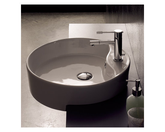 "Scarabeo - Circular Semi-Recessed White Ceramic Bathroom Sink - This contemporary semi-recessed round white ceramic sink is made in Italy by Scarabeo. Bathroom sink includes overflow and has a single faucet hole. Sink dimensions: 18.10"" (width), 5.10"" (height), 18.10"" (depth)"