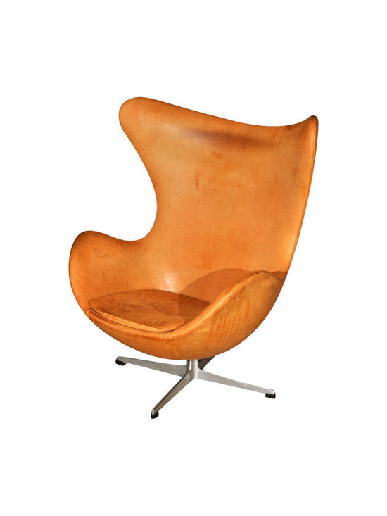 Leather Egg Chair - Here's the egg chair in a nice, patina'd leather.  Love the counterpoint of the modern lines of the chair with the aged, textured quality of the leather.