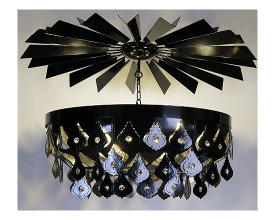 Black Medusoid by O'Hare & D'Jafer - This striking leather chandelier is constructed of vegetable tanned, black leather and sewn with a matching leather thong stitch. Shown here with large lead crystals inset on each of the individual facets. The metal ceiling rose is an additional bespoke option. Made from 34 individual, back-lit blades which create drama and ambience in any space.
