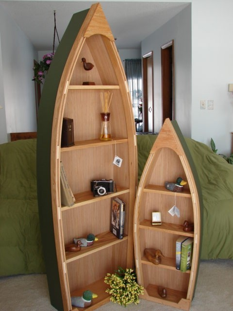 Six-Foot Handcrafted Wood Row Boat Bookshelf By Poppas Boats eclectic bookcases cabinets and computer armoires