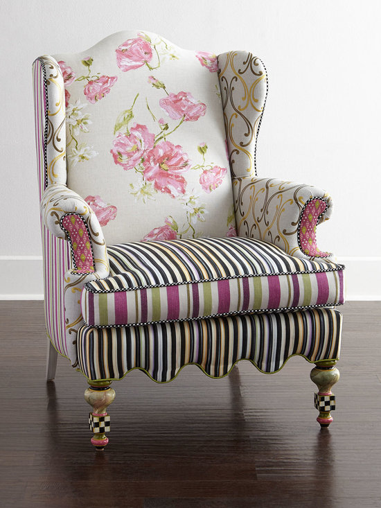 "MacKenzie-Childs - Summerhouse Wing Chair - MULTI COLORS - MacKenzie-ChildsSummerhouse Wing ChairDetailsHandcrafted wing chair.Upholstered in cotton/linen rayon/linen and rayon/polyester/cotton fabrics.Due to the nature of handcrafting chairs may vary.34""W x 30""D x 42""T.Made in the USA.Boxed weight approximately 70 lbs. Please note that this item may require additional delivery and processing charges.Designer About MacKenzie-Childs:Established in 1983 MacKenzie-Childs combines vibrant colors and patterns to create a whimsical collection of tableware furniture and decorative accessories that epitomize ""tradition with a twist."" The company's designers draw inspiration from the pastoral setting of their studios located on a 65-acre former dairy farm in Aurora New York."