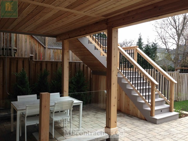 Pvc Deck With Glass Railings And Walkout Basement Modern