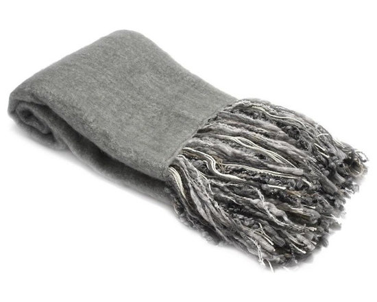 Belle & June - Grey Mohair Throw - You will be smitten with this mosaic, mohair grey throw. A cozy wrap, to warm your feet at the foot of the bed, this throw will look fabulous when 'thrown' on a couch or chair. The silk-like mohair yarn, made from the Angora goat, is a textured and luxurious fabric; even more so with the lustrous fringe.