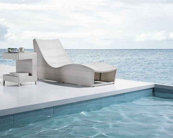 Jarino Chaise Lounge & Side Table - Featuring a unique curved frame and also including the side table, this Jarino Lounge Set brings style and versatility to your patio.
