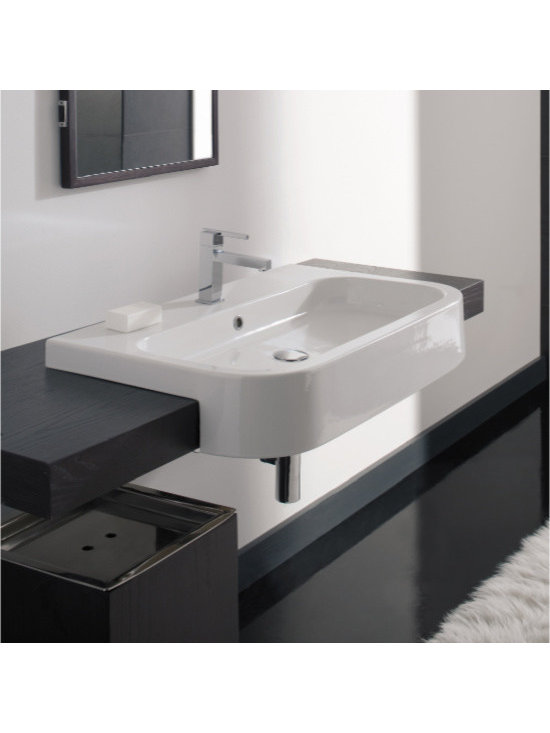 "Scarabeo - Stylish Modern White Ceramic Semi Recessed Sink by Scarabeo - Stylish modern white ceramic semi recessed rectangular bathroom sink with curved front. Made of high quality white ceramic. Designed and manufactured in Italy by Scarabeo. Lavish washbasin includes overflow and a single faucet hole. Sink dimensions: 31.90"" (width), 5.30"" (height), 19.70"" (depth)"
