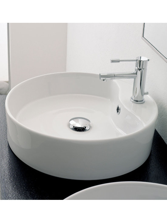 "Scarabeo - Beautiful Round White Ceramic Vessel Sink by Scarabeo - Beautiful above counter vessel sink made in Italy by Scarabeo. This round white ceramic sink includes a single faucet hole and overflow. Sink dimensions: 17.70"" (width), 5.10"" (height), 17.70"" (depth)"
