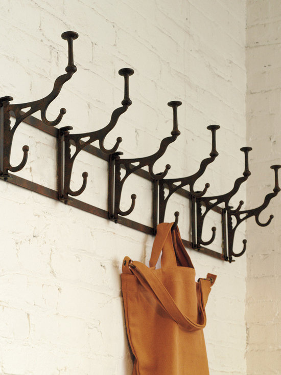 "Rejuvenation: Entry - The original of this ingenious folding hook rack made its way to our salvage department, and then onto the wall of our web team's office. After passing – and admiring – the rack every day, our hardware designers knew we had to reproduce it. Ideal for spots where space is tight, the hooks are hinged to fold flat, out of the way. Note the ""button"" top on the upper part of each hook: it was originally designed to support fine hats without marring their contours."