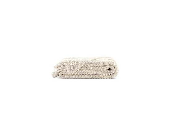 Organic Cotton Knit Blanket - Inspired by thick, fishermen's style sweaters, this Organic Cotton Blanket will quickly become your favorite when relaxing at home. Hand knit from 100% certified organic cotton yarns, this Blanket has an extra soft, silky feel. No bleaches, harsh chemicals or dyes have been used on these yarns, which meet the Global Organic Textile Standard (GOTS). Dry clean only. Made in India. DWR Exclusive