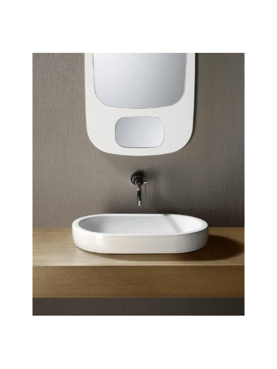 "GSI - Flat Sleek Oval Shaped Ceramic Vessel Sink by GSI - Contemporary styled flat above counter vessel bathroom sink made of high quality white ceramic. Elongated oval shaped sink has no faucet holes and does not include overflow. Made in Italy by GSI. Sink dimensions: 21.70"" (width), 5.90"" (height), 13.80"" (depth)"