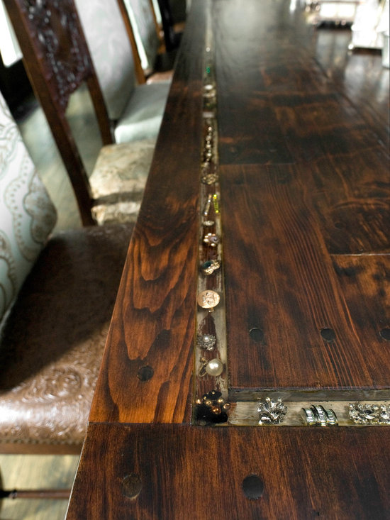 Dining Table Detail - In the dining room, the table was made onsite from reclaimed red wood. An inset border featuring many pieces of vintage jewelry and cufflinks from the homeowners' families, all secured in clear resin, allowed them to add a personal touch.