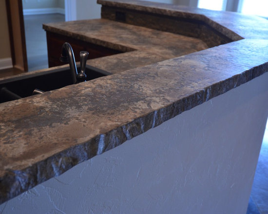 Red Baron Architectural Concrete Products - Red Baron Architectural designs and manufacturers countertops, sinks,backsplashes, fireplace mantles and other products out of concrete.