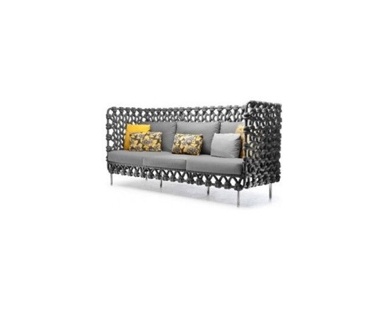 Eco Friendly Furnture and Lighting - he Cabaret Sofa is a sofa with fabric tubes woven around a steel frame for an interesting texture and pattern. The indoor version is available in three colors: charcoal gray, plum, and sand. An oudoor version is available as well.