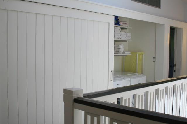 Sliding Landry Nook Doors contemporary-laundry-room