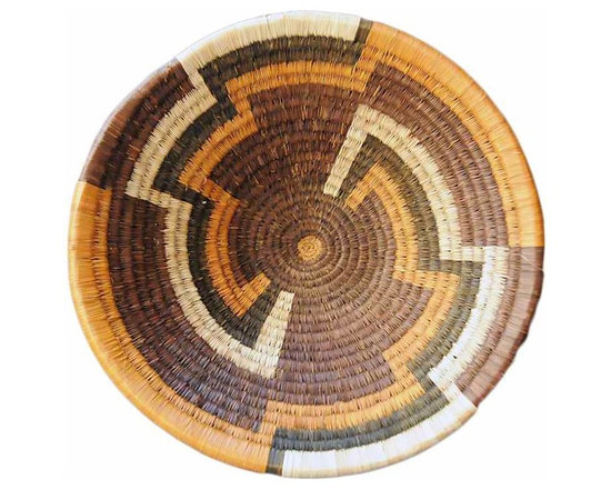 Botswana Delta Basket - Women of the Bayei and Hambukushu tribal groups painstakingly create this art from 'mokola' palm tree fiber coil woven around grass or vine.