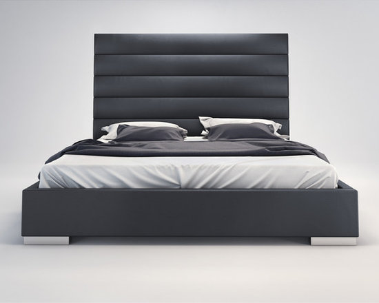 Prince Bed by Modloft - Adorn your bedroom with the striking Prince bed. Its strong appearance features a tall leather panel-tufted headboard standing five feet tall. Tapered leather side rails and footboard complete the bed, and because of its trim proportions, the Prince can accommodate any limited space rooms. Low profile chrome feet finish its modern appearance perfectly. The mattress sits snuggly atop a solid pine-slat base for stylistic durability and added comfort. Platform height measures 14 inches (2 inch inset). Available in California-King, Standard King, Queen, and Full sizes. Colors available include White and Dusty Grey bonded leathers. Assembly required. Mattress not included. Imported.