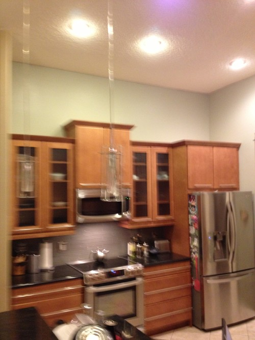 What to put above kitchen cabinets in a tall kitchen - What to do with the space above kitchen cabinets ...