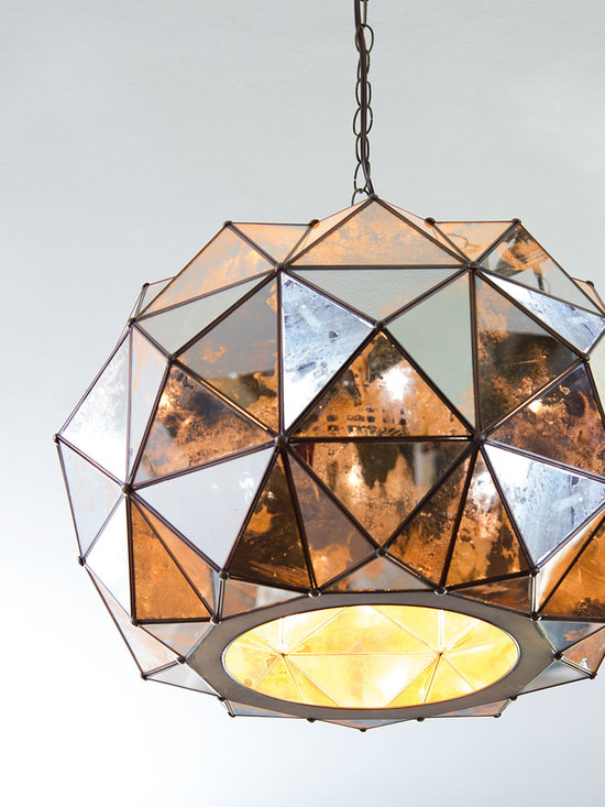 Lighting - An arrangement of mirrored-glass pyramids gives this intriguing pendant light a faceted look. It reflects its surroundings as it lights the room.