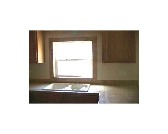Full view of travertine Kitchen countertop and window -