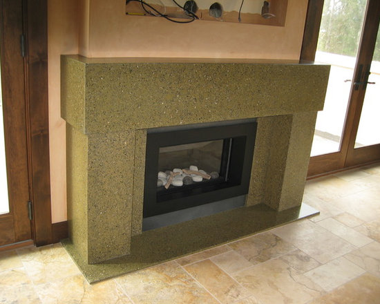Bloomfield Road - Custom concrete fireplace in a beautiful moss green, with graphic levels that serve as visual pillars and a functioning mantle.