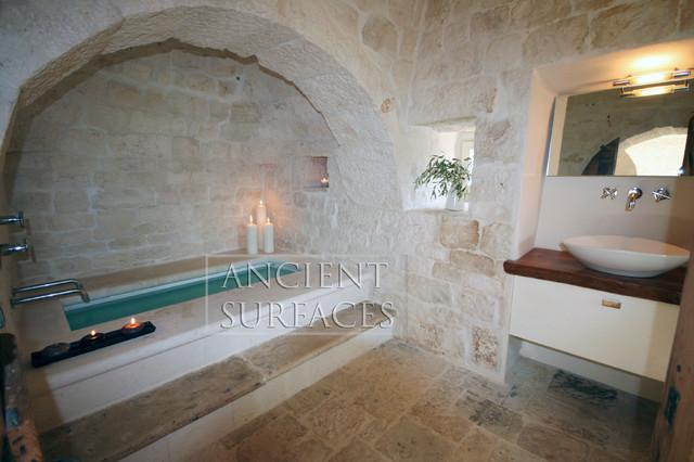 Master Bathrooms in antique limestone mediterranean-tile