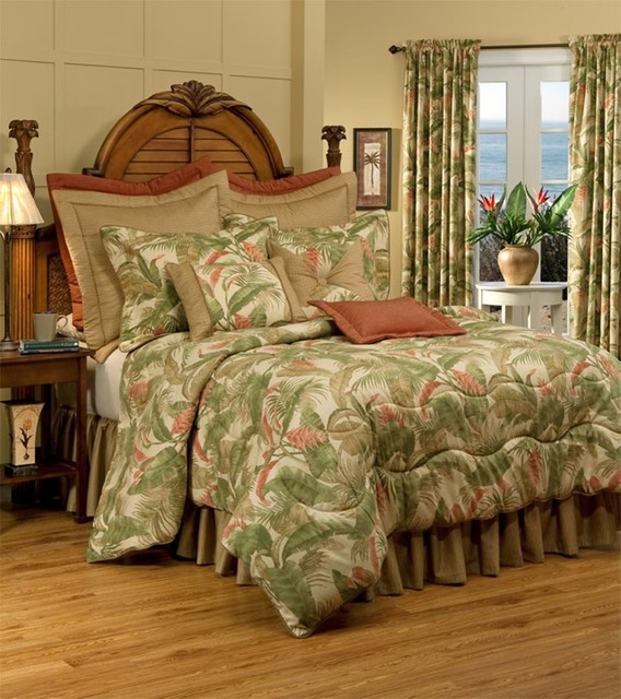 Add a touch of the lush feel of the tropics with this classic tropical bedding design featuring a comforter set in shades of green and orange on a black background, completed with coordinating accent.