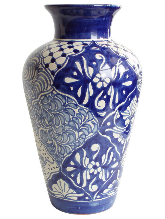 Especial Vase, Christina - Everybody needs a classic blue and white vase (or three). This curvy masterpiece has a floral pattern reminiscent of coastal gardens and warm sea breezes. Pair with a big bouquet of sunflowers and set on the kitchen table for the ultimate in easygoing elegant style.