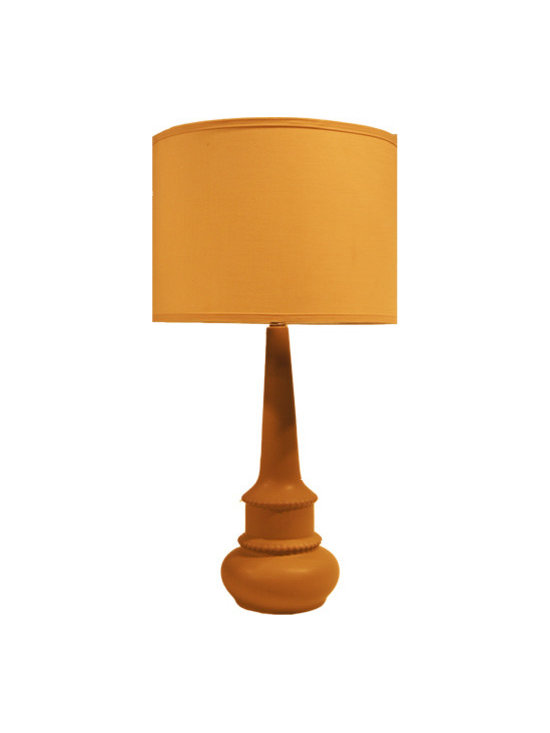Sacamento Matte Griffin Lamp - This pretty and elegant lamp is gorgeously traditional while still seeming fresh and contemporary. The rounded porcelain base is long and lean while the substantial linen shade perfectly accents the whole look. Try using this in any room to add warmth and depth.